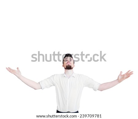Young man with arms raised. Guy  spread hands out.  Isolated on white background.  Bearded student wearing a white shirt arms opened looking up.  - stock photo