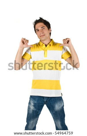 Young man with attitude  showing with thumbs  to his t-shirt - stock photo