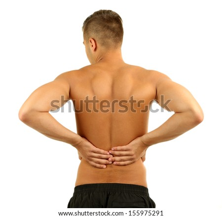 Young man with back pain, isolated on white