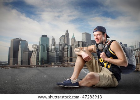 young man with backpack in new york - stock photo