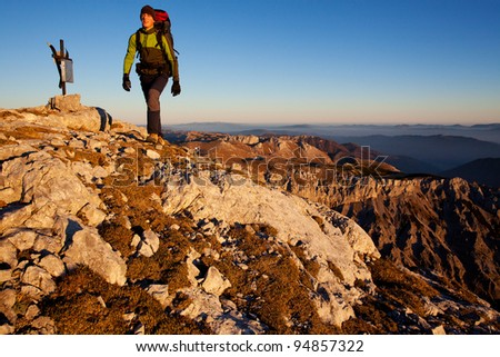 Young man with backpack on a mountain hike
