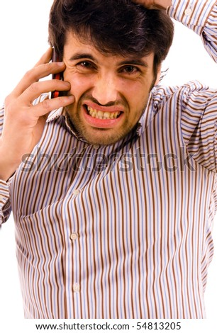 young man with bad news on his cell phone - stock photo