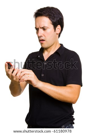 Young man with bad news on is cellphone - stock photo