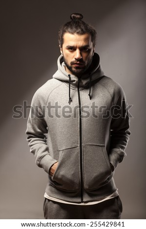 young man with beard and bun in tracksuits - stock photo