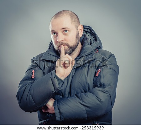 Young Man with Beard Thinking Doubting and Considering a Decision - stock photo