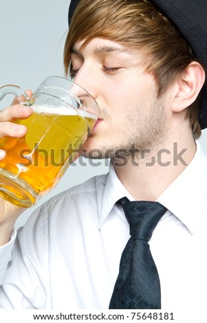 young man with beer - stock photo
