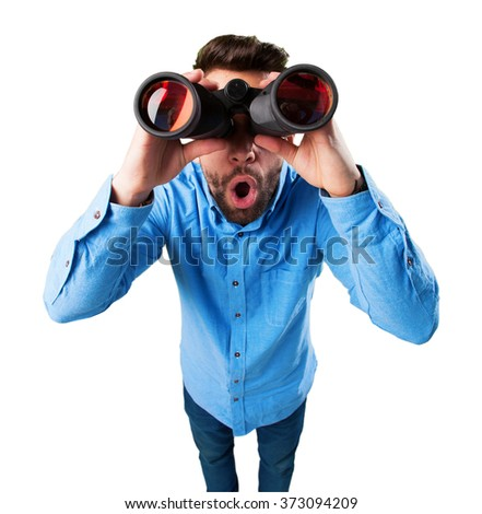 young man with binoculars surprised - stock photo