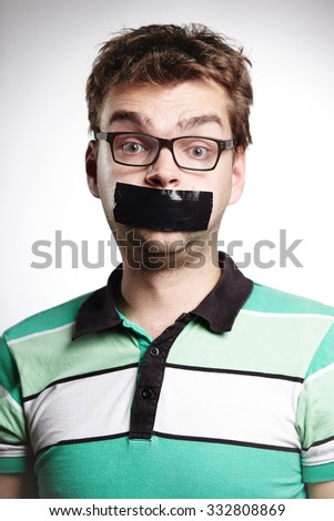 Young man with bonded mouth - stock photo