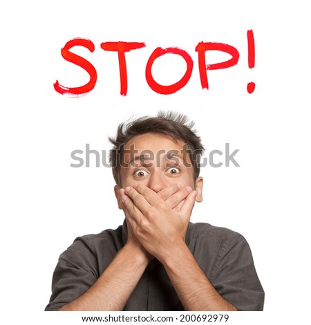 "Young man with both hands closing mouth, with ""Stop!"" text, isolated - stock photo"