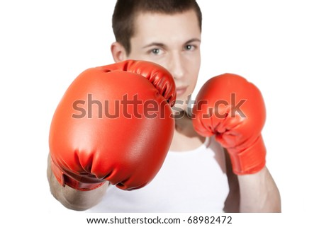Young man with boxing glove. - stock photo