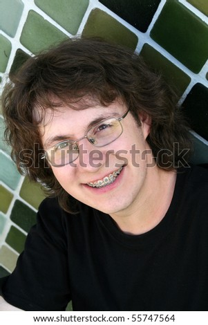 Young man with braces and glasses - stock photo