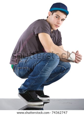 Young man with breakdancing clothes isolated over white background. - stock photo