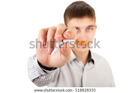 Young Man with broken Cigarette in a Hand closeup on the White Background