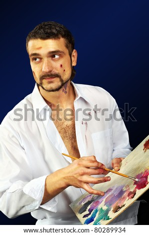 young man with brursh and palette - stock photo
