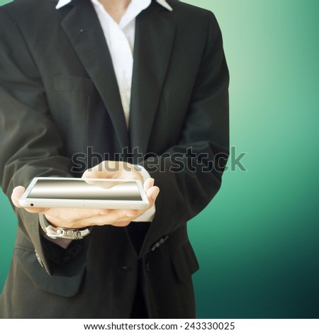 Young man with business suit with a tablet in the hand - stock photo