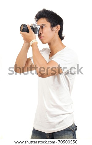 young man with camera - stock photo