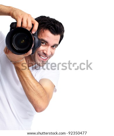 Young man with camera. Isolated over white background. - stock photo