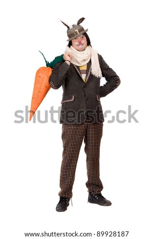 Young man with carrot dressed in a suit rabbit. Isolated - stock photo