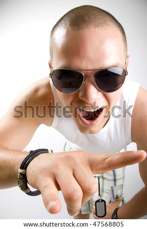 Young man with characteristic heavy metal hand gesture