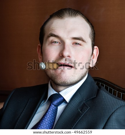 Young man with cigar