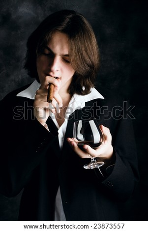 young man with cigar and glass of cognac
