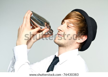 young man with cocktail - stock photo