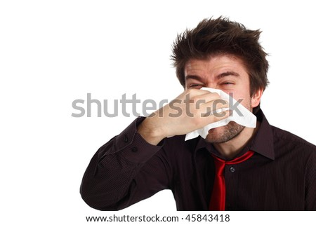young man with cold virus blowing his nose - stock photo