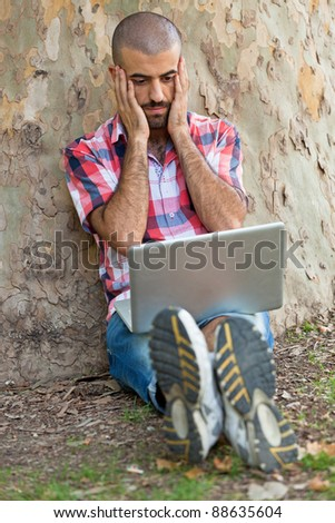 Young Man With Computer at Park
