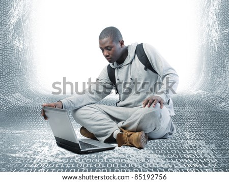 young man with computer on 3d virtual background - stock photo