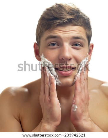 young man with cream - stock photo