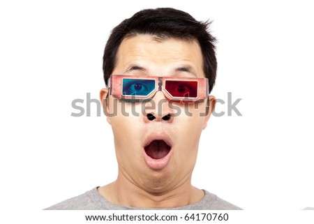 Young man with 3D glasses on watching a 3D movie - stock photo