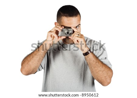 Young man with digital camera shooting away