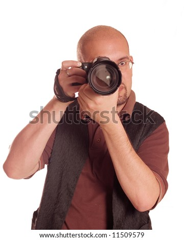Young man with digital camera taking picture