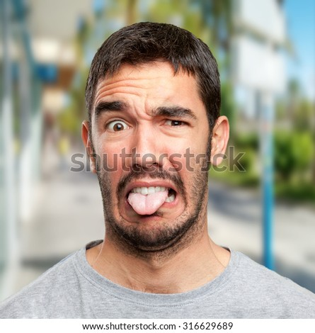Young man with disgust - stock photo
