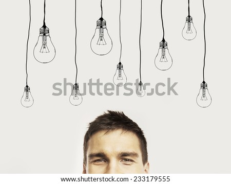 young man with drawing bublbs - stock photo