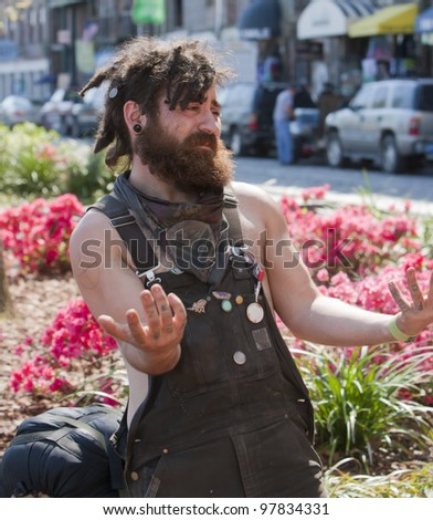 Young man with dreadlocks and tattoos. Shot outside during the daytime - stock photo