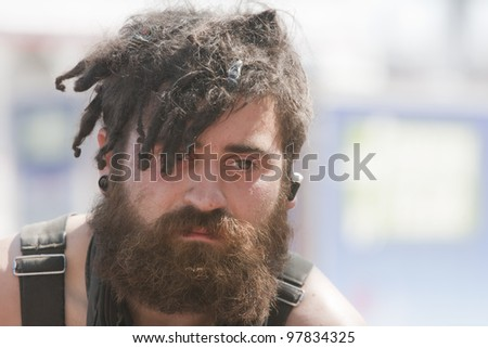 Young man with dreadlocks. Shot outside during the daytime - stock photo