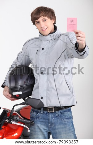 young man with driving license - stock photo