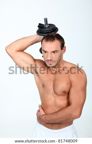 young man with dumbbell - stock photo