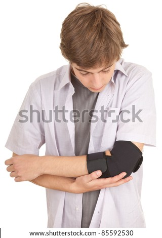 young man with elbow in medical bandage, elbow support - stock photo