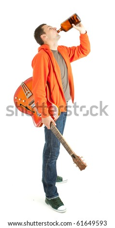 young man with electric guitar drinking alcohol from brown bottle