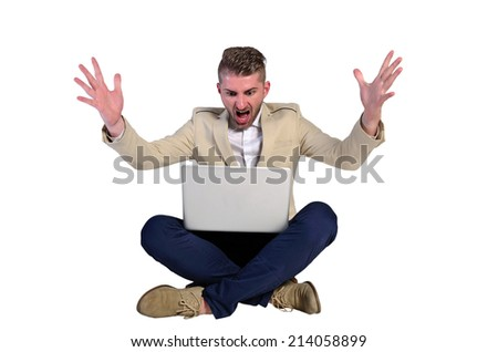 young man with elegant suit yelling on white background - stock photo