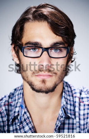 young man with eyeglasses - stock photo