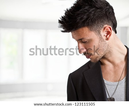 Young man with fashion hairstyle - stock photo