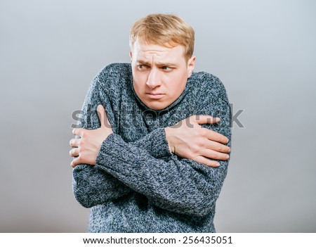 Young man with feeling cold  - stock photo