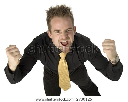 young man with fists up and hostile expression - stock photo