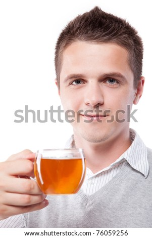 Young man with fresh cup of black tea - stock photo