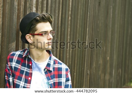 young man with glasses and hat