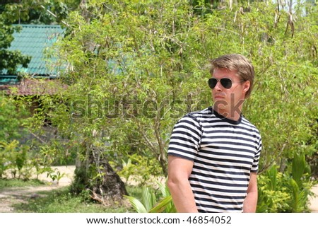 young man with glasses on vacation - stock photo