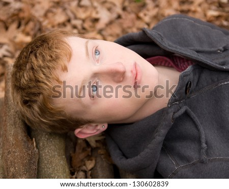 Young Man With Gorgeous Blue Eyes Outside - stock photo